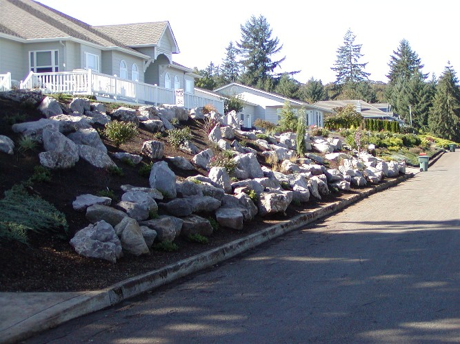 Same bank after boulders placed