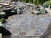 Mortared patio with boulders, bridge, pathway & waterfeature